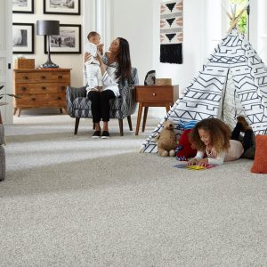 Family on Grey Carpet | Thornton Flooring