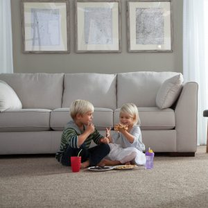 Kids enjoying food in living room | Thornton Flooring